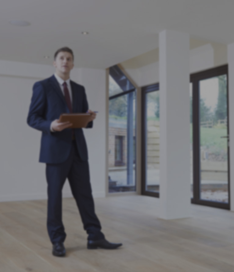 A man valuating a property